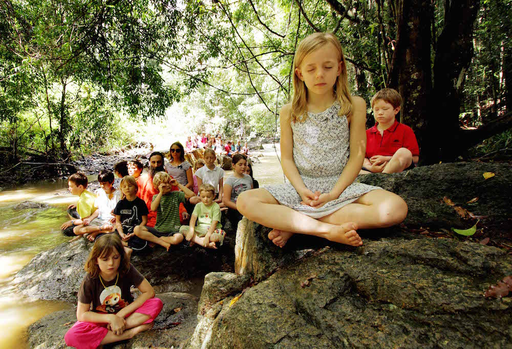 BSM-Sunshine Coast- NEWS-17/02/2011 Ananda Marga River School Year 1 students Charlotte Richards 6 and fellow students meditate as a part of their daily school routine. They are pictured at the stream that runs through the Ananda Marga River School at Maleny. Picture: Robyne Cuerel Story: Kathleen Donaghey alternativeschool1702d